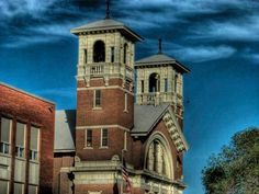 Photo Of The Bell Towers At St Edwards Catholic Church Across From City Park