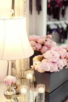 love long boxes of flowers. entryway decor? need to find some good looking fake peonies.