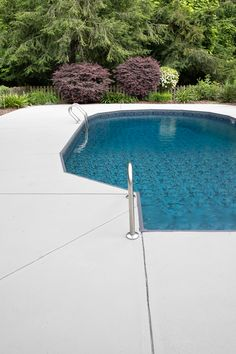 DIY Painted Concrete Pool Deck and Patio - Bless'er House A full step-by-step tutorial to paint a concrete pool deck and patio to make it last and save thousands by doing it yourself.