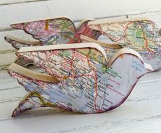 Wooden birds (or other wood cutouts), map modge-podged on. Neat idea for remembering all the places we move to?