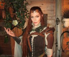 site is in Norwegian but this lady is AMAZING! She's so pretty and has super cool costumes and I WANT HER HAIR!! (elvenkingdom)