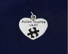 Autism Touches Us All Charms.Each charm is approximately 2.3 cm x 2.4 cm. Packaged 25 charms per pack. Product Code: CHARM-01AT