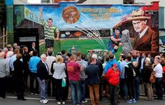 Crowds gather as a new mural is unveiled in Belfast to mark the life of footballer Patrick O'Connell, whose career saw him play for Belfast Celtic and Manchester United and manage FC Barcelona. Photo: Niall Carson