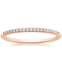 Delicate rose gold diamond band.