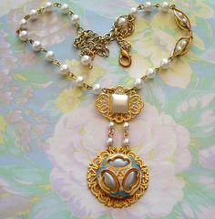 Vintage Enamel and Glass Button Pendant Necklace with an Asymmetrical Pearl Chain by joyceshafer on Etsy