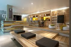 cafe/smoothie bar/lounge area in wellness center Qi Urban Lobby Wellness Centre by Manada, Mexico City benches with white, charcoal, and chartreuse cushions Gym Interior, Lobby Interior, Interior Exterior, Interior Architecture, Wood Interiors, Office Interiors, Commercial Design, Commercial Interiors, Lounges