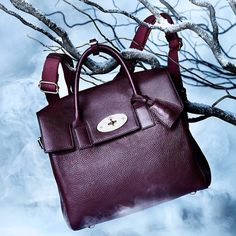"""@bazaarthailand's photo: """"BOOK OF WONDER: HANDBAGS Will you succumb to the lure of the bag this Christmas? Cara Delevingne's perfectly practical bag for Mulberry has it all - utilitarian looks and a multi-tasking design in sumptuous oxblood leather."""""""