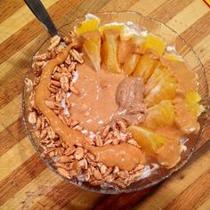 Cottage cheese, greek yogurt, stevia, and cinnamon, mixed and topped with an orange, puffed barley, pb2, and a mix of pb and almond butter.