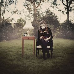 Laura Williams reading Alice in Wonderland Creepy Photography, Surrealism Photography, Dark Photography, Portrait Photography, Themed Photography, Levitation Photography, Exposure Photography, Abstract Photography, Alice In Wonderland Aesthetic