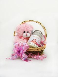 A beautifully presented pink teddy bear and a baby powder scented candle make this basket the perfect gift to welcome the new addition!  Price 14.99  http://luxuryhampers.ie/p/welcome_baby_girl_basket