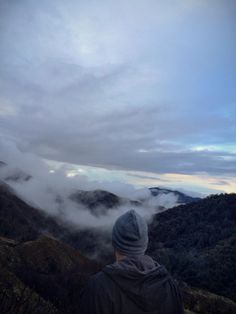 'And when you gaze long into an abyss, the abyss also gazes into you.' #mountains #clouds #fog #sunset