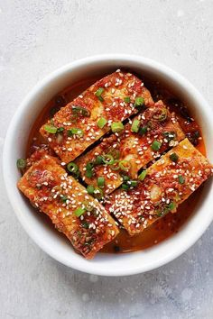 Spicy Korean Tofu - quick and easy Korean braised tofu with chili powder, garlic, soy sauce, sugar and sesame oil. This Korean side dish (banchan) is healthy and delicious | rasamalaysia.com