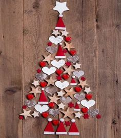 Photo about New design for a christmas tree - red and white decoration for xmas on a wooden brown background. Image of greetings, noel, colored - 34585448 Diy Christmas Tree, Christmas Crafts For Kids, Xmas Tree, Christmas Projects, Simple Christmas, Holiday Crafts, Christmas Holidays, Christmas Ornaments, Beautiful Christmas
