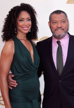 """Laurence Fishburne and Gina Torres - Fishburne met Torres while they were both filming """"The Matrix: Reloaded"""" and married in The actress, born in New York to Cuban parents, and the Tony Award winning actor welcomed a daughter, Delilah, in Black Celebrity Couples, Black Love Couples, Cute Couples, Power Couples, Celebrity Pictures, Black Actors, Black Celebrities, Celebs, Hollywood Celebrities"""