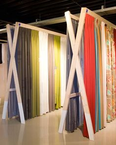 Fabric displays in showrooms google search visual for Curtain display ideas