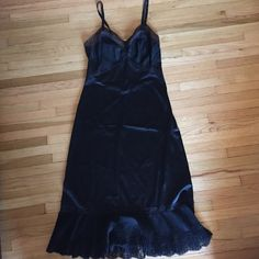 Vintage black slip dress Black slip with bottom ruffle hem• lace details along bottom, neckline, and back• adjustable straps• only show of wear is a small pulled area (pictured)  and some slight fading on top part of the lace• size 32 (would fit a size 0-4, 32 B) Vintage Intimates & Sleepwear Chemises & Slips