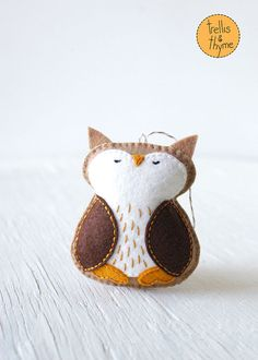 This listing is for an instant-download PDF-PATTERN. It is not a finished toy. Woodland Owl is sweet and handsome. Hes perfect for your living room, nursery, or work-space. (No matter where he is, hes sure to bring a smile.) This felt pattern is stitched entirely by hand, and is perfect for beginners. Finished ornament is approximately 3.75 inches tall. Skills required: - Basic embroidery skills - Blanket stitch - Back stitch - Stem stitch - Applique stitch This PDF pattern includes…