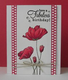 Like the way the poppies are stamped on center panel with designer paper as a fram on the sides, but both run all the way to the top of the card base.