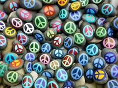 A great image for use in the classroom for a writing assignment on peace! The rocks are hard and gray and not all facing the same way. The peace signs are colorful and bright.....What makes something peaceful?