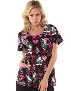 Red ribbons, pink hearts plus the adorable Minnie Mouse in one scrub top Cherokee Tooniforms Valentine in Before The Date print design. These vibrant colors are printed all over the black 100% cotton sheeting fabric.