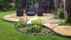 circular patio to add interest and planting corners to our otherwise angular yard