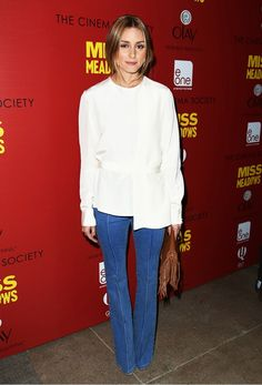 Olivia Palermo makes a pair of flares look stylish with an elegant wrap blouse and fringe purse.