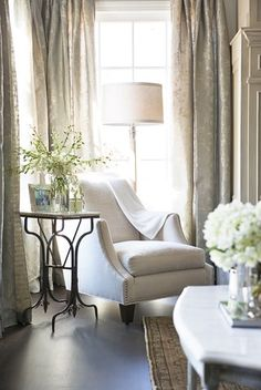 Digging the cool/unique side table.  It's bones remind me of an old Singer Sewing machine my mother had as I was growing up.  Love the oversized chair too...cozy and inviting!