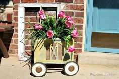 diy spray painted magazine rack planter on wheels, crafts, flowers, gardening, home decor, repurposing upcycling