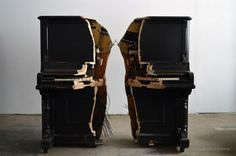 An Antique Piano Eviscerated in Half Connected Only by a Wishbone