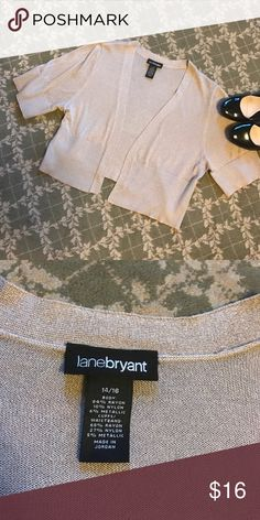 Lane Bryant Gold Threaded Short Sleeved Cardigan Such a cute cardigan!! Perfect for a holiday party with a cute dress, or for a night out! In good used condition. Size 14/16. You can see the color best in picture 3! Lane Bryant Sweaters Cardigans