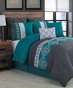Cool contrasting colors on this eight-piece bedding set create a cozy look to highlight your bedroom décor.