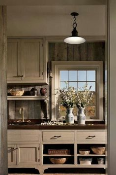 FARMHOUSE – INTERIOR – vintage early american farmhouse showcases raised panel walls, barn wood floor, exposed beamed ceiling, and a simple style for moulding and trim, like in this farmhouse kitchen by john b. Primitive Kitchen, Rustic Kitchen, Kitchen Sink, Rustic Backsplash Kitchen, Country Kitchen Cabinets, Open Cabinets, Wood Backsplash, Nice Kitchen, Stylish Kitchen