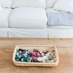 basket of crystals on the coffee table
