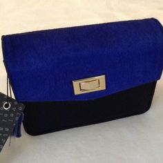 """Was $45 Crossbody/Clutch New blue Clutch Size 7W-5 1/5H"""" approx.  Discount on bundles. No Trades. No PayPal Bags"""