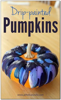 Drip-painted pumpkins - a beautiful way to decorate pumpkins with preschoolers for Halloween! || Gift of Curiosity