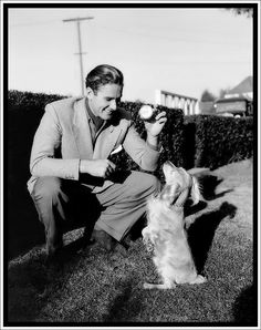 0 errol flynn playing with dog Hollywood Men, Old Hollywood Stars, Hooray For Hollywood, Golden Age Of Hollywood, Vintage Hollywood, Errol Flynn, Actors Male, Handsome Actors, Vancouver