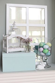 blue box, birdcage, mirror, eggs.