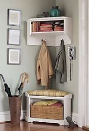 "Corners seem to get a bad rap. They are generally regarded as a waste of space. However, with a little ingenuity, these often dismissed areas of our home can become an active and functional part of your everyday life. For example, we think this ""Samantha"" Corner Bench and Shelf by PotteryBarn, is perfect for a small entryway. The bottom bench has an open area to hold a basket or your shoes, and the top shelf has hooks for jackets and bags. The top shelf also includes a cubby for additional…"