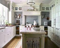 white kitchen with gray backsplash tiles plus many more white kitchen ideas on site