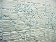 DIY with a large map or atlas just figure latitude and longitude lines. Purple erase marker it and start stitching!  Have to try this one:)