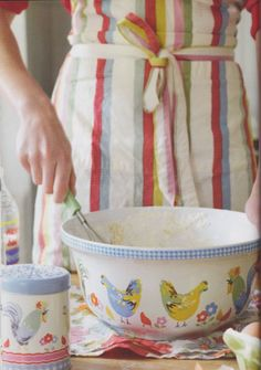 Brightening the Kitchen with a Vintage Apron and Vintage Hen-themed Bowls.