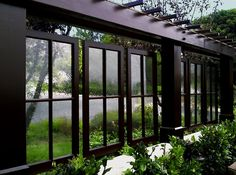 Beautiful use of hanging windows to delineate outdoor spaces.