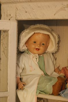 One of my antique composition dolls in my old cabinet.