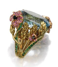 GEM SET AND DIAMOND RING, 'INCROYABLES ET MERVEILLEUSES', VICTOIRE DE CASTELLANE FOR DIOR.  Set with an oval aquamarine to a mount depicting flowers and wheat sheaves, set with circular-cut tsavorite garnets, pink sapphires, onyx and brilliant-cut diamonds, size 54, sizing band, signed Dior and numbered, French assay and maker's marks, case stamped Dior.