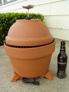 Make your own little brown egg~ a terracotta smoker.  Instructions