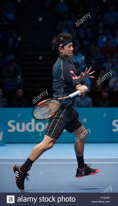 Kei Nishikori (JPN) in Day 5 singles action at the ATP World Tour Finals 2015, O2 arena playing Roger Federer. Stock Photo