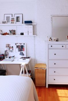 organization above a small working desk space in a studio apartment. I like how she's kept it white so the fabrics she uses 'pop'. Jacqueline's Bright & Airy West Village Studio House Tour | Apartment Therapy