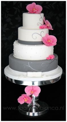 Gray and white with pink fondant flowers, I know not orchids for you but I like the colors