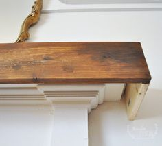 Build a DIY Faux Beam Fireplace Mantel Cover - Jennifer Rizzo Build a DIY Faux Beam Fireplace Mantel Cover Update your fireplace mantel like we did for our faux fireplace, and use lumber to create an inexpensive DIY Faux Beam Fireplace Mantel Cover. Rustic Fireplace Mantels, Diy Mantel, Brick Fireplace Makeover, Wood Mantels, Home Fireplace, Fireplace Remodel, Fireplace Update, Fireplace Decorations, Fireplace Cover Up