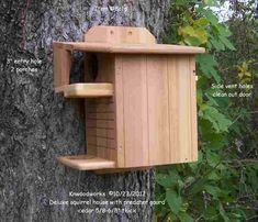 CEDAR squirrel house - with porch - about $55
